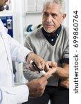 doctor checking of senior... | Shutterstock . vector #699860764
