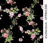 Stock photo watercolor painting of leaf and flowers seamless pattern on dark background 699861388