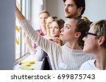 a team of focused work... | Shutterstock . vector #699875743