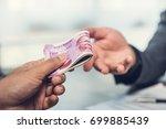 businessman giving money ...   Shutterstock . vector #699885439