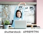 office woman stretching body... | Shutterstock . vector #699899794