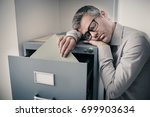 tired lazy office worker... | Shutterstock . vector #699903634