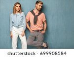 fashion girl and guy in outlet ... | Shutterstock . vector #699908584