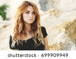 curly haired woman posing  near ... | Shutterstock . vector #699909949
