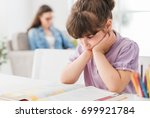 lazy bored young girl studying... | Shutterstock . vector #699921784