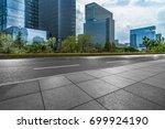 cityscape with empty road floor | Shutterstock . vector #699924190