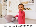 portrait of mixed race kid at... | Shutterstock . vector #699925990