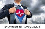 businessman in superhero... | Shutterstock . vector #699928276