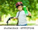 Little Boy Drinking Water By...