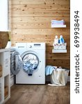 interior of a real laundry room ... | Shutterstock . vector #699938494