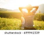 woman watching the sunset. rear ... | Shutterstock . vector #699941539