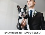handsome man in a suit with dog ... | Shutterstock . vector #699941650