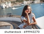 beautiful young woman on yacht. ... | Shutterstock . vector #699943270