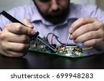 chip soldering man hands | Shutterstock . vector #699948283