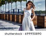 beautiful woman walk on the... | Shutterstock . vector #699950890