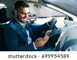 satisfied young business man... | Shutterstock . vector #699954589