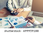 business people calculate with... | Shutterstock . vector #699959188