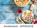 homemade christmas cake on blue ... | Shutterstock . vector #699961018
