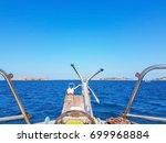 Blue Sea View Through Sail Boa...