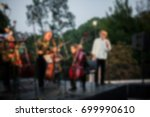 Small photo of Background for design, blur texture, actors on stage scene in concert with silhouettes of people. De focused/ Blurred image of the conductor introducing musical composition before performance.