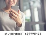 woman hand holding mobile phone ... | Shutterstock . vector #699995416