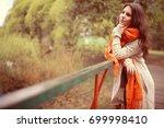 girl happy autumn park | Shutterstock . vector #699998410