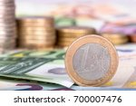 banknotes and euro coins | Shutterstock . vector #700007476