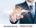 a businessman is touching a... | Shutterstock . vector #700011430