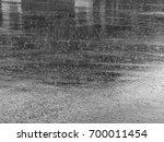 rain drop on wet asphalt road... | Shutterstock . vector #700011454
