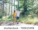 couple in forest walk | Shutterstock . vector #700015498