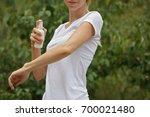 mosquito repellent. woman using ...   Shutterstock . vector #700021480