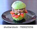 avocado bun burger with red... | Shutterstock . vector #700025356