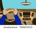 human hands driving a car | Shutterstock .eps vector #700025923