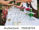 buffet table and waiters... | Shutterstock . vector #700028704