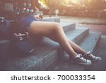 girl in checkered shirt sitting ... | Shutterstock . vector #700033354
