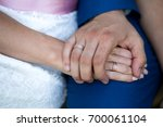 Small photo of Two hands holding, man covers woman hand. Beautiful young couple, wedding romantic date. Sincere devotion feelings of love charm tenderness. social problem family, fidelity in marriage, conjugal duty