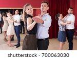 young positive people dancing... | Shutterstock . vector #700063030