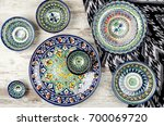 ethnic uzbek ceramic tableware. ... | Shutterstock . vector #700069720