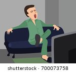 man yawns sitting in front of... | Shutterstock .eps vector #700073758