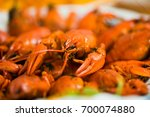 cooked craw fish on a plate... | Shutterstock . vector #700074880