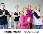 group of seniors doing exercises | Shutterstock . vector #700078810