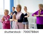 group of seniors doing exercises | Shutterstock . vector #700078864