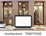 blank screen laptop  coffee cup ...   Shutterstock . vector #700079200