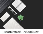 the keyboard and supplies lying ... | Shutterstock .eps vector #700088029