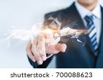 a businessman is touching an... | Shutterstock . vector #700088623