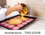 the confectioner fills the... | Shutterstock . vector #700110358