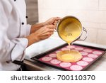 the confectioner fills the... | Shutterstock . vector #700110370