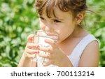 child drinks water.  | Shutterstock . vector #700113214