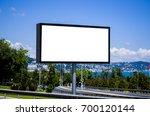 blank white billboard and... | Shutterstock . vector #700120144