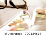 close up white book marked by... | Shutterstock . vector #700134619